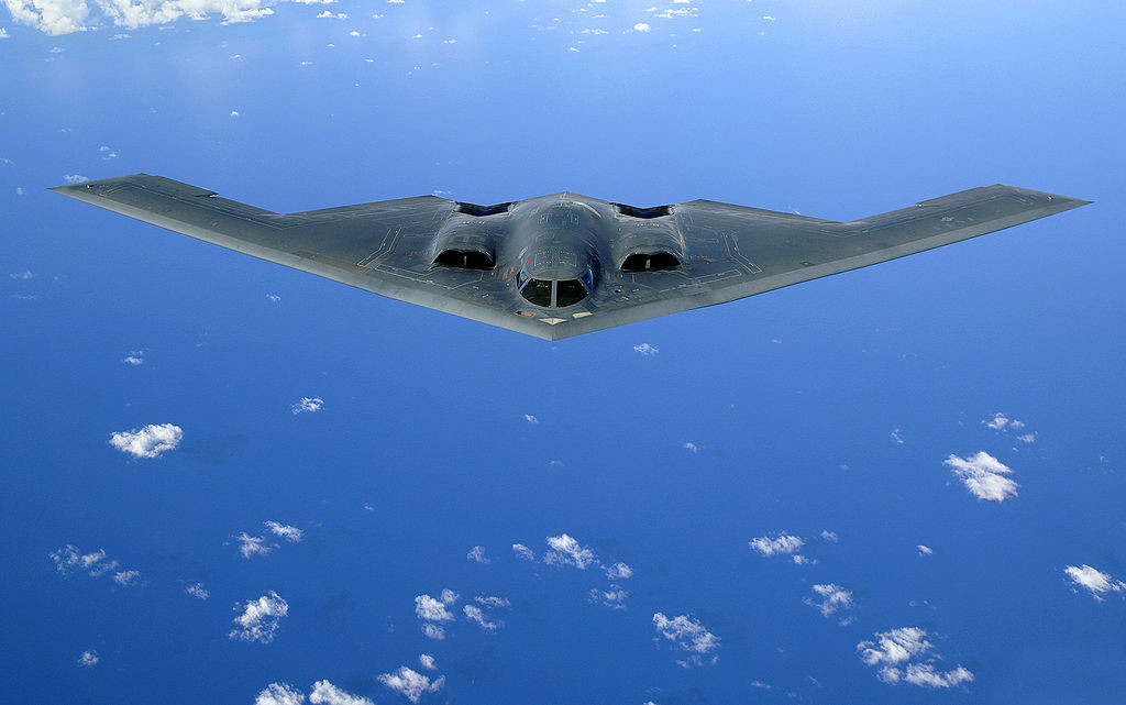 Photo of a B-2 Spirit fighter plane in the sky.