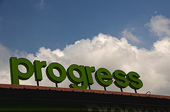 Progress sign on building