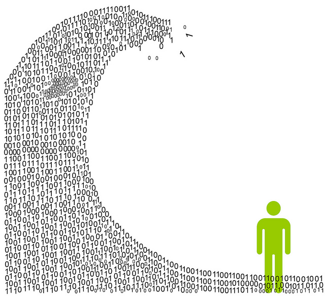 Silhouette of man being overtaken by wave made out of 1's and 0's