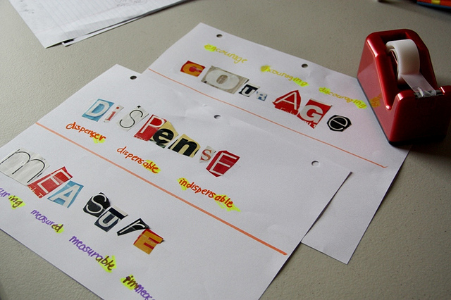 Letters cut from newspapers to form vocabulary sheets