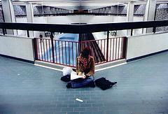 Woman studying on floor