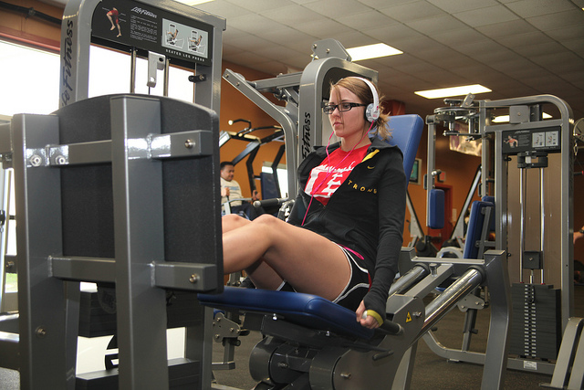 Woman doing leg presses on weight machine