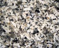 Figure 2. Granite is made of four minerals, all visible to the naked eye: feldspar (white), quartz (translucent), hornblende (black), and biotite (black, platy).