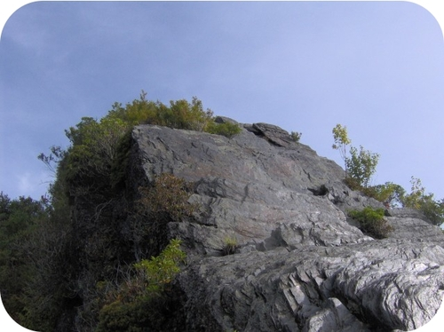 Figure 16. The platy layers in this large outcrop of metamorphic rock show the effects of pressure on rocks during metamorphism.