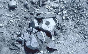 "Tephra block (also called a ballistic) on the crater floor of Mount St. Helens about 100 m from the lava dome. This lava fragment was blasted from the dome by a short-lived explosion caused by either (1) a vigorous release of gas from magma within or beneath the dome; or (2) by superheated groundwater ""flashing"" to steam. The rock broke apart when it landed on the crater floor."