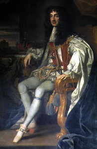 Oil painting of Charles II.  He is sitting at an angle to the viewer, turned to face the viewer straight on.  His hair is chest-length black curls.  His crown rests on a table beside him.