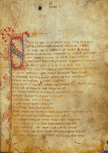 """Photo of a fragile paper manuscript page.  The writing is in calligraphy, in Middle English, with a large ornate """"S"""" in blue and red ink as the first letter of the text."""