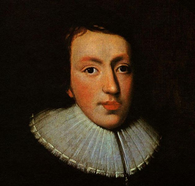 Oil painting of John Milton as a young man.  His hair is dark and blends in with the background.  He is clean-shaven with rosy cheeks and lips, and wears a ruffled white collar on dark clothing.