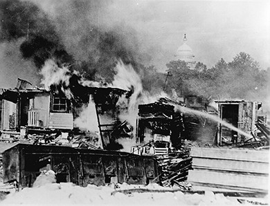 A photograph shows the burning of veterans' camps at Anacostia Flats.