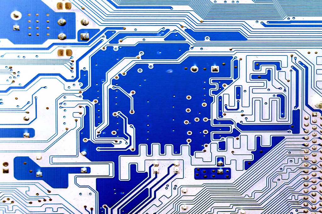 Photo of a blue computer circuit board.