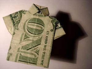 dollar bill folded to resemble a shirt