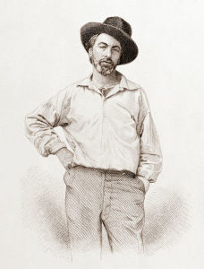 Steel engraving of Walt Whitman.  He is standing in casual clothes and a hat, with one hand against his hip and the other in his pocket.