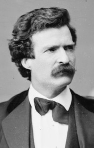 Black and white photo of Mark Twain as a young man, with dark hair and a thick mustache.
