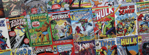 Photo of three rows of comic books laid side-by-side.  The photo is at an angle, so that the middle row is displayed clearly but top and bottom rows are cut off at either end.  Titles of comics include Silver Surfer, Fantastic Four, The Defenders, Amazing Spider-Man, The Incredible Hulk, and Giant-Size X-Men.