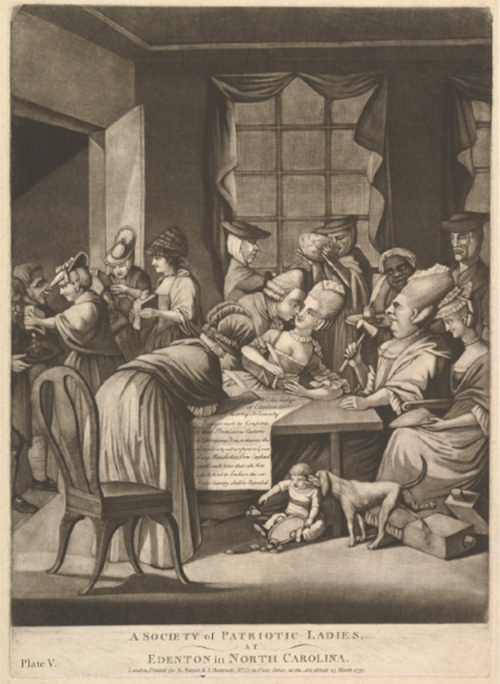 Women gathered around and writing a document.