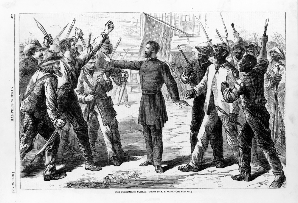 A group of white men and black men face off against each other. Both groups are armed. Between the two groups is a white man wearing a uniform. He is facing the white group and holding out a hand.