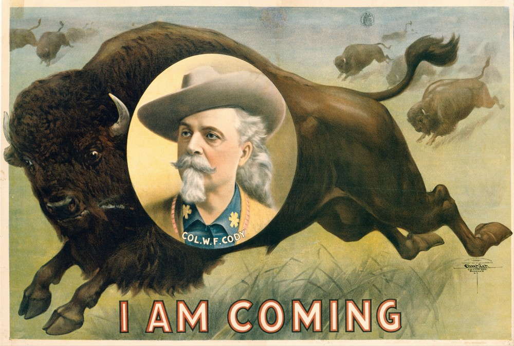 Portrait of Buffalo Bill in front of a buffalo with the words I Am Coming.