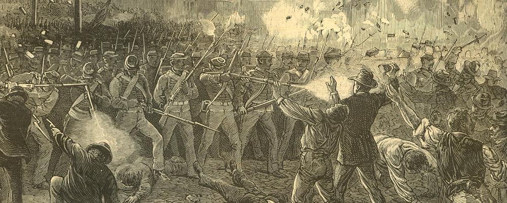 Uniformed men firing rifles at a crowd.
