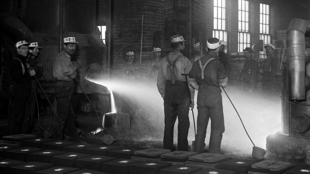 Men in a moulding room.