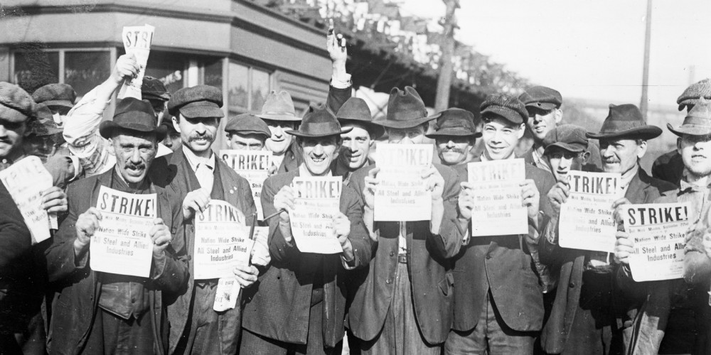 Men holding signs that say Strike! Nationwide Strike All Steel and Allied Industries.
