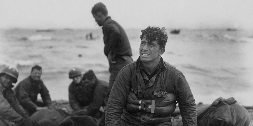 Tired soldiers on a beach.