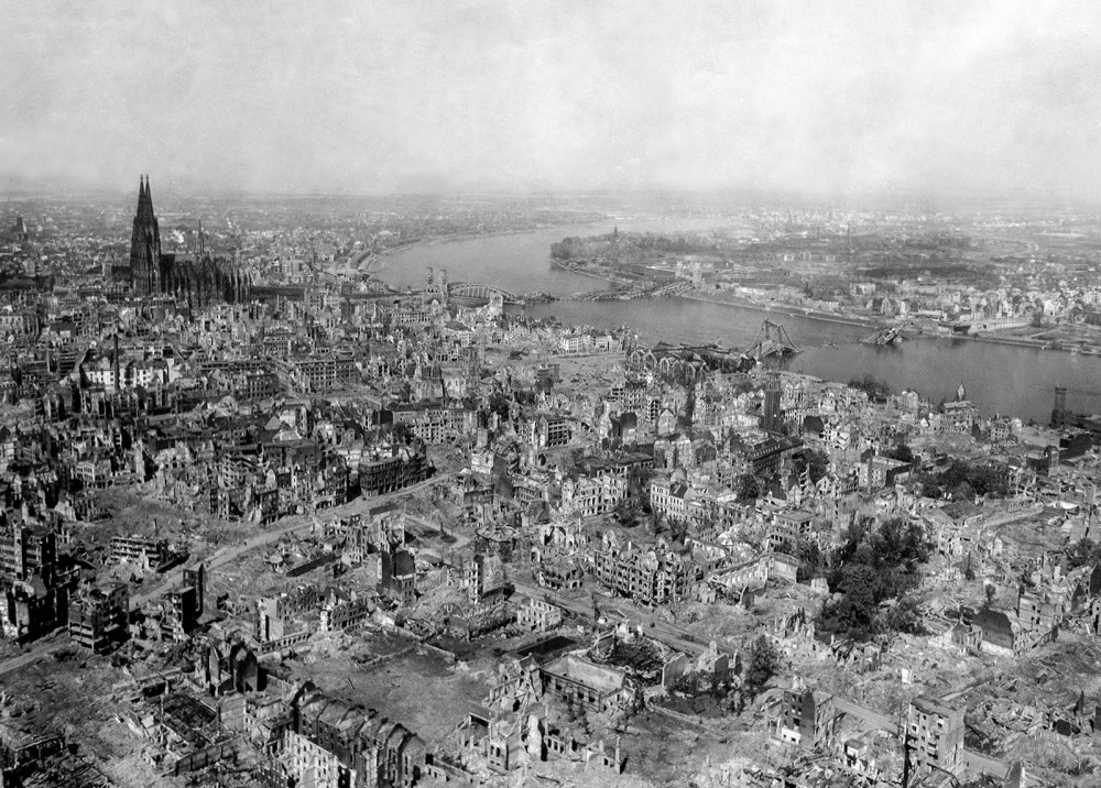 A bird's eye view of Cologne, Germany. Parts of the city have been leveled, and many parts have ben reduced to rubble.