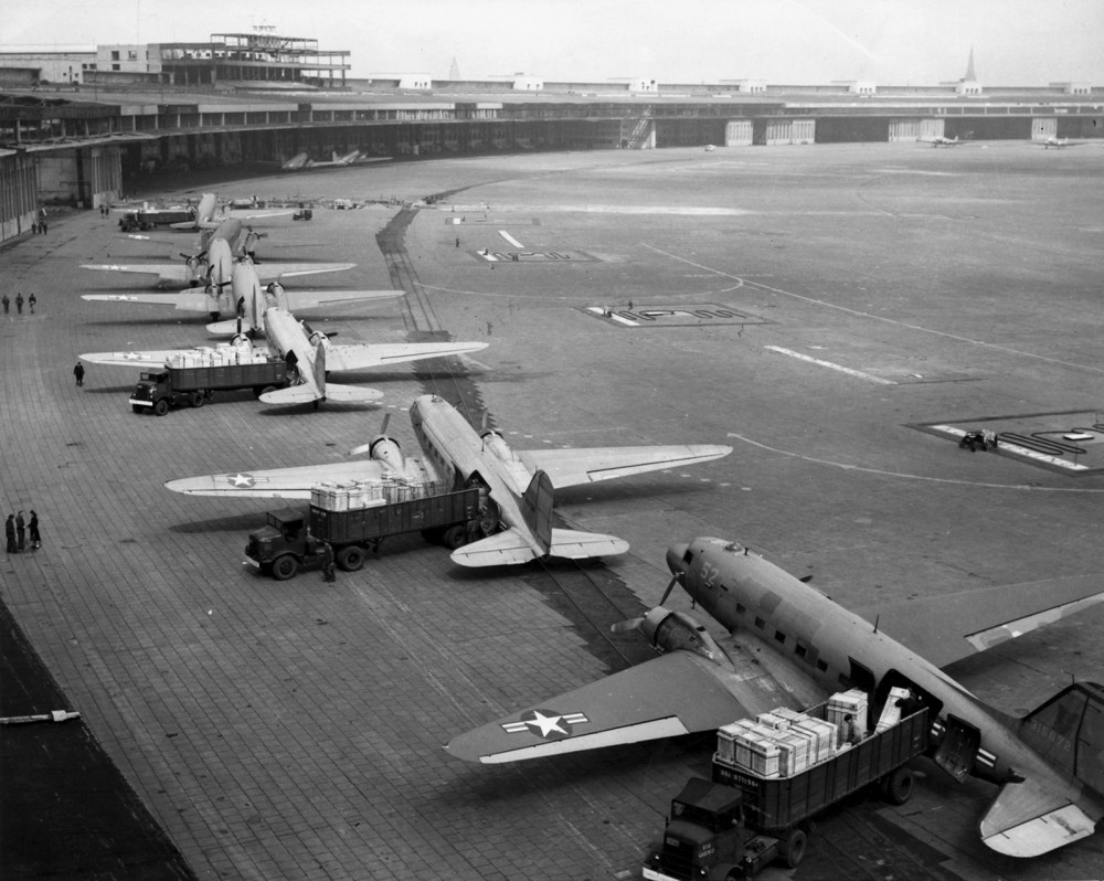 A line of planes on the ground.