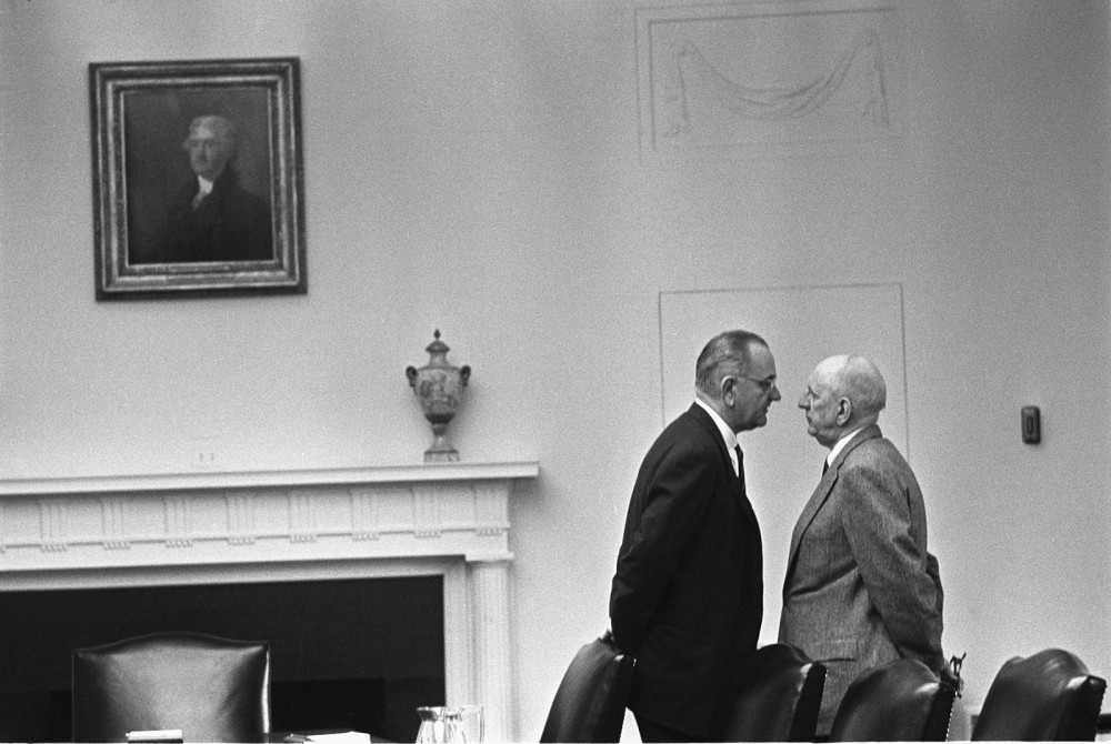 Lyndon B. Johnson standing very close to Senator Richard Russell. Their faces are inches apart.