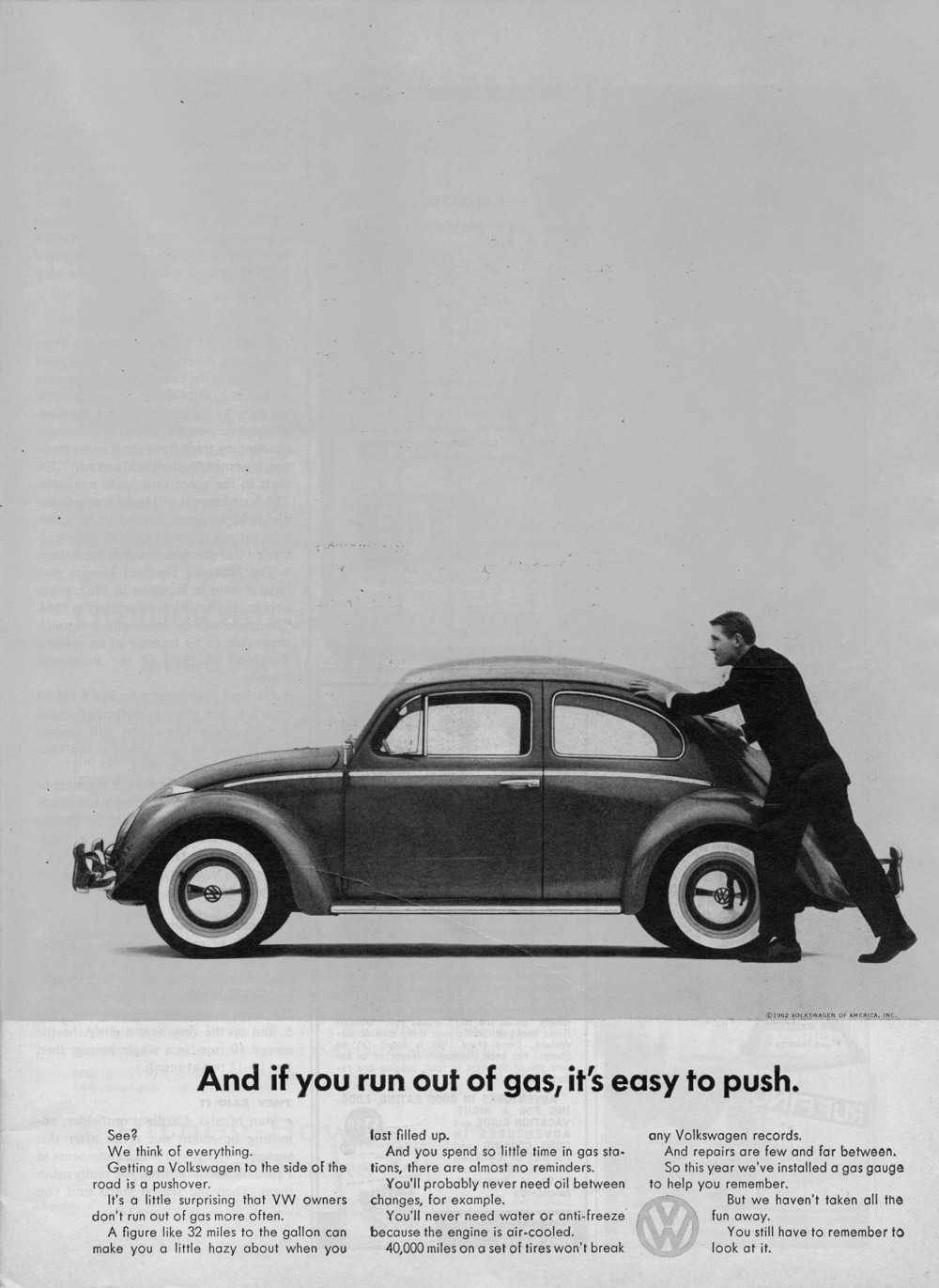 Advertisement featuring a man pushing a Volkswagen Beetle. The ad says, And if you run out of gas, it's easy to push.