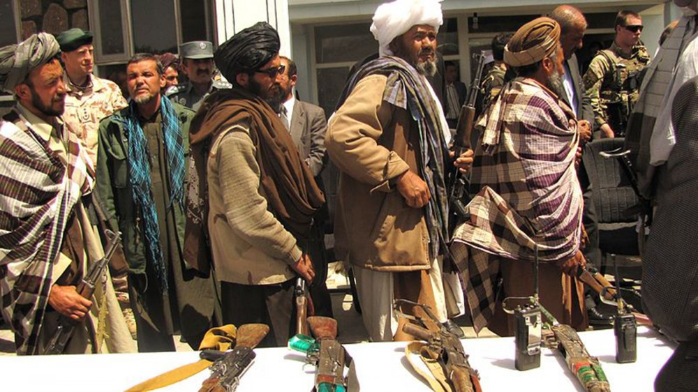 A line of Taliban fighters.
