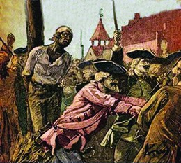 An illustration shows a black man tied to a stake with kindling aflame at his feet; white soldiers holding guns push back a watching crowd.