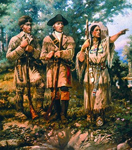 A painting depicts Sacagawea leading Lewis and Clark through the Montana wilderness. She points authoritatively ahead while Lewis and Clark look on.
