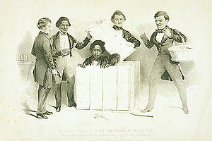 "Old lithograph showing Henry ""Box"" Brown emerging from a shipping box while four people watch with surprised expressions."