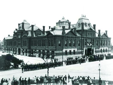 A photograph shows a long line of strikers facing a long line of Illinois National Guardsmen in front of a railroad building.