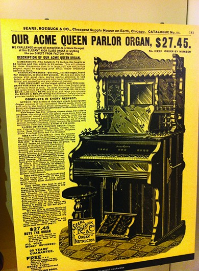 "A page from the Sears, Roebuck & Co. catalog advertises, ""Our Acme Queen Parlor Organ, $27.45,"" followed by a drawing and description of the product. The header of the page reads ""Sears, Roebuck & Co., Cheapest Supply House on Earth, Chicago."""