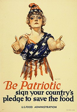 "A poster shows a drawing of a young white woman with her arms outstretched toward the viewer. She wears an American flag wrapped around her body and a matching cap. The text reads ""Be patriotic. Sign your country's pledge to save the food. U.S. Food Administration."""