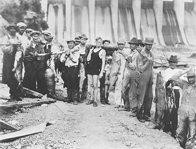 A photograph shows a group of TVA workers standing in front of the Wilson Dam.