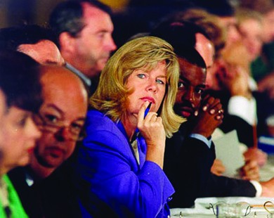 A photograph shows Tipper Gore seated at a table at a Senate hearing.
