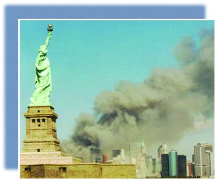 A photograph shows the New York skyline with the Statue of Liberty in the foreground. In the background, massive plumes of smoke rise from the twin towers.