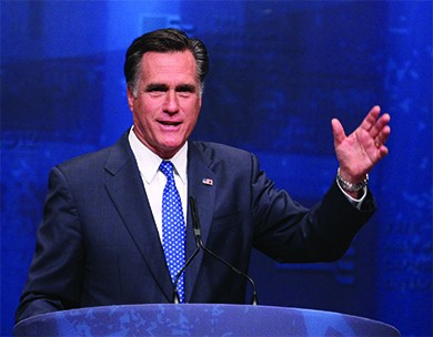 A photograph shows Mitt Romney speaking at a lectern.