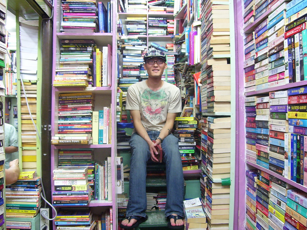 A man sitting in a bookstore