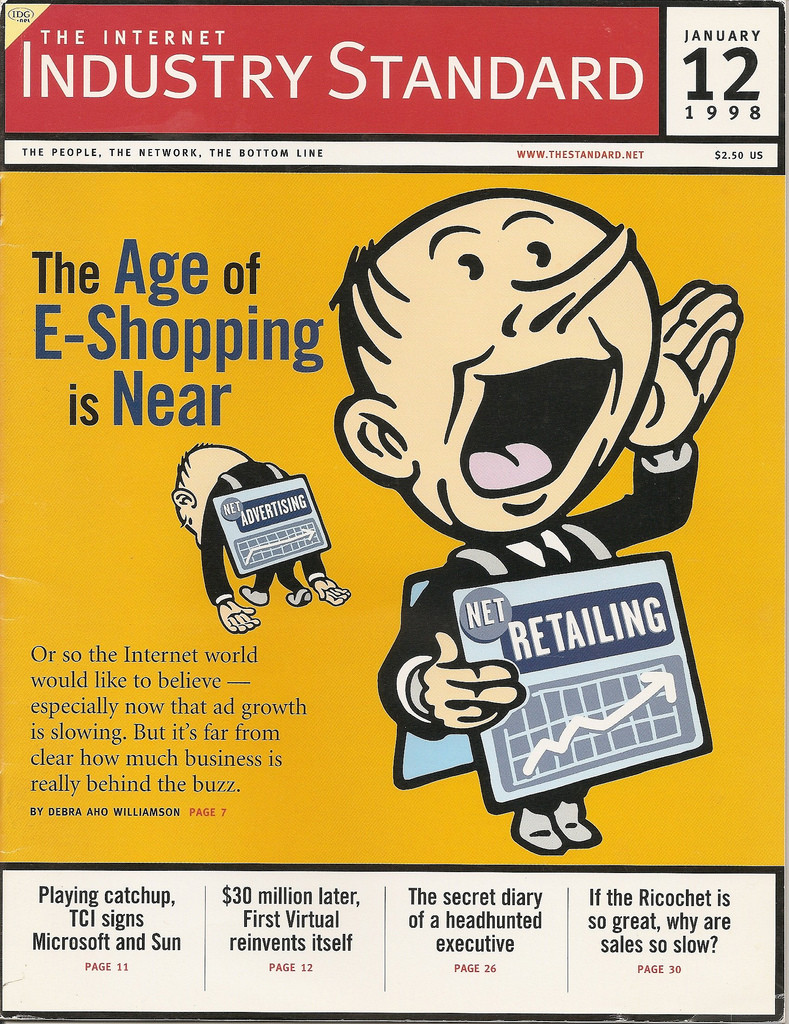 """Cover of 1998 Internet Industry Standard journal showing a cartoon man announcing that """"The Age of E-Shopping is Near."""""""