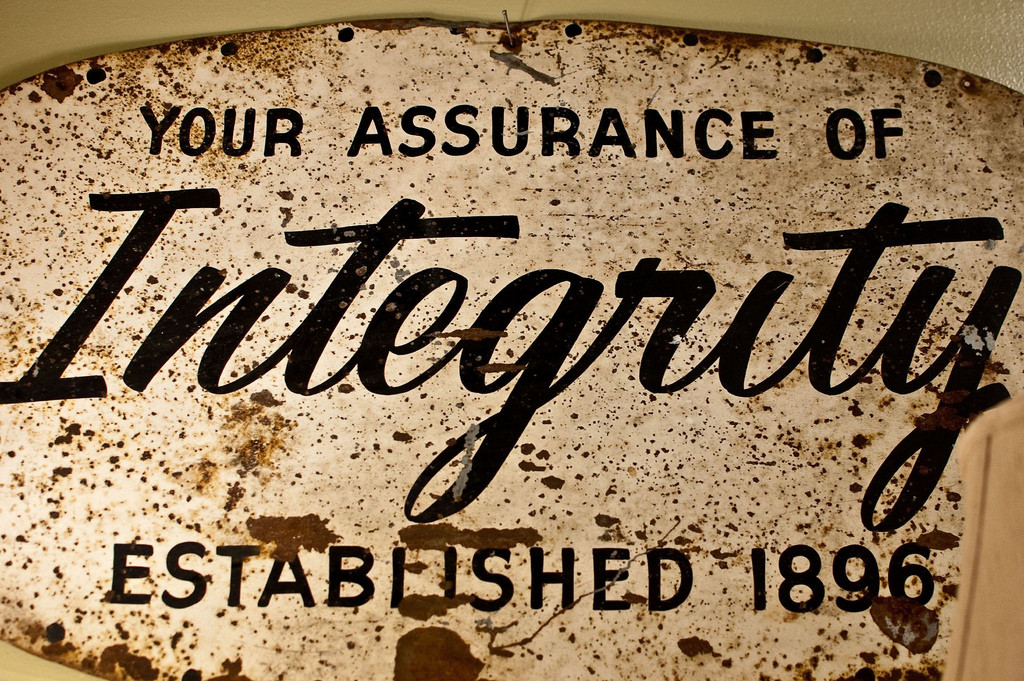 """A sign that reads """"Your Assurance of Integrity. Established 1896."""""""