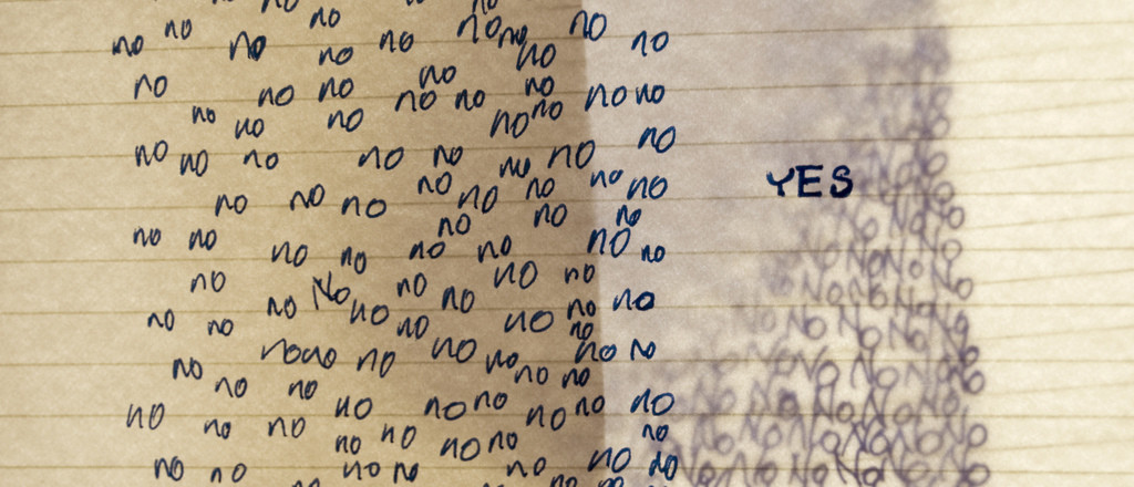 Lined notebook paper with the word No written repeatedly on the left; on the right is the single word Yes.