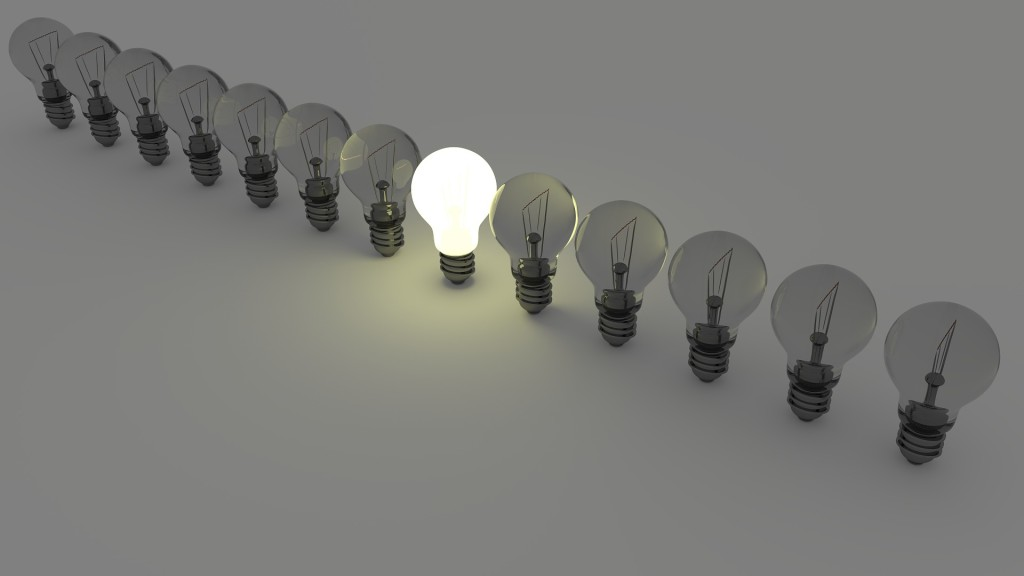 A line of lightbulbs. Only one is lit.