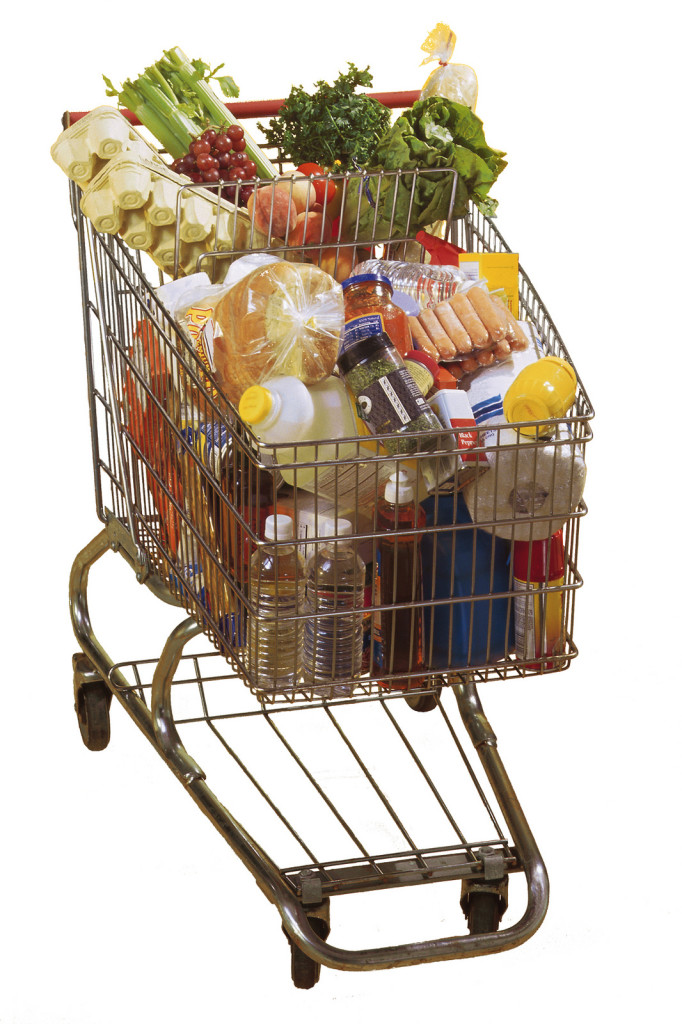 A shopping cart full of groceries.