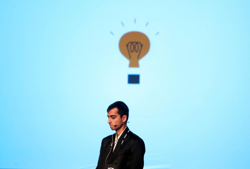 A man beneath a cartoon light bulb.