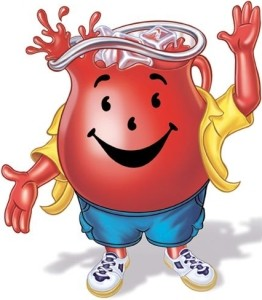 A giant pitcher of kool-aid wearing shorts and a yellow button up, smiling.