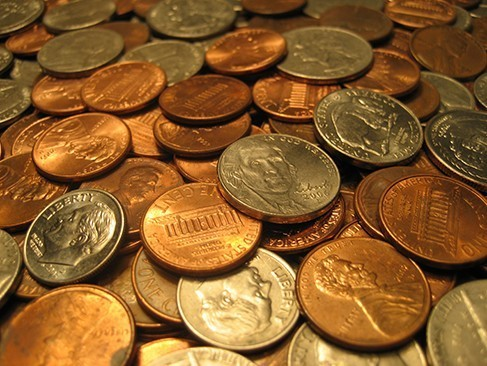 A pile of quarters, dimes, nickels, and pennies.