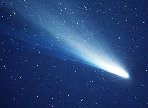 A comet streaking across a starry sky.